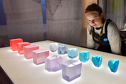 "© Licensed to London News Pictures. 27/06/2017. London, UK. A staff member views ""Crystal Stones"", 2017, in morning light.  Preview of ""Breathing Colour"", an exhibition by acclaimed designer Hella Jongerius, at the Design Museum, Kensington which comprises a series of newly commissioned installations exploring humans perceptions and connections to colour.  The exhibition runs from 28 June to 24 September 2017.  Photo credit : Stephen Chung/LNP"
