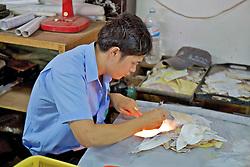 Man Working In Handicraft Factory