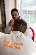 A peer advisor sponsored by the St Giles trust talking to a prisoner. HMP/YOI Portland, Dorset, United Kingdom.