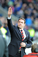 Cardiff city manager Malky Mackay waves to the fans just ahead of k/o.  Barclays Premier league, Cardiff city v Southampton at the Cardiff city Stadium in Cardiff,  South Wales on Boxing day, Thursday 26th Dec 2013. <br /> pic by Andrew Orchard, Andrew Orchard sports photography.