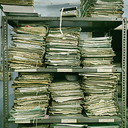 A pile of paperwork in an office, showing heavy bureaucracy.
