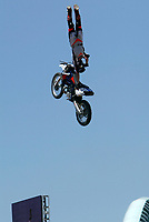 """Jul 01, 2003; Anaheim, California, USA; Moto X star athlete RONNIE RENNER catches vertical air at Disney's California Adventure """"X Games Experience"""".  <br />Mandatory Credit: Photo by Shelly Castellano/Icon SMI<br />(©) Copyright 2003 by Shelly Castellano"""