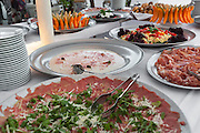 party outdoors, laid table with food, tasty appetizer