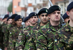 © licensed to London News Pictures. London, UK 10/03/2012. London's Territorial Army soldiers, many of whom have taken part in overseas operations in Iraq and Afghanistan marching on Kensington High Street this noon (10/03/12). Photo credit: Tolga Akmen/LNP
