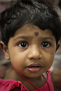 A girl of an Indian descent shops with her mom in Little India district in Georgetown on Penang, Malaysia