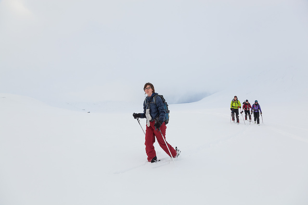 Michelle Blade (l-r), Nate Stevens, Anouk Vlug, and Kiya Riverman ski into Foxdalen, Svalbard.