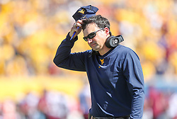 Sep 18, 2021; Morgantown, West Virginia, USA; West Virginia Mountaineers head coach Neal Brown walks along the sidelines during the third quarter against the Virginia Tech Hokies at Mountaineer Field at Milan Puskar Stadium. Mandatory Credit: Ben Queen-USA TODAY Sports