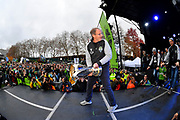 Seattle Sounders head coach Brian Schmetzer carries the MLS Cup trophy, followed by the Sounders team members during the MLS Cup Champions Parade & Rally on November 12, 2019 in Seattle, Washington, to celebrate the Sounders' win over Toronto FC to win the MLS Cup soccer match in Seattle. (Alika Jenner/Image of Sport)