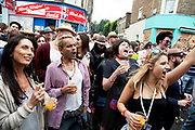 Crowds enjoying the sound systems at the Notting Hill Carnival in West London. The Notting Hill Carnival is an annual event which since 1964 has taken place each August, over two days (the August bank holiday Monday and the day beforehand). It is led by members of the West Indian / Caribbrean community, particularly the Trinidadian and Tobagonian British population, many of whom have lived in the area since the 1950s. The carnival has attracted up to 2 million people in the past, making it the second largest street festival in the world. The celebration centres around a parade of floats, dancers and sound systems.