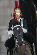 The Queen's cavalry soldier is seen wearing a black fabric over his uniform as he stands on a horse to observe the minute silence salute outside Horse Guards Parade in central London on Saturday, April 17, 2021, during the funeral of Prince Philip of the United Kingdom. The Queen announced the death of her beloved husband, His Royal Highness Prince Philip, Duke of Edinburgh who died at age 99. HRH passed away peacefully on April 9th at Windsor Castle after 73 years of marriage to Britain's Queen Elizabeth II. (Photo/ Vudi Xhymshiti)