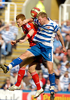 Photo: Ed Godden/Sportsbeat Images.<br />Reading v Liverpool. The Barclays Premiership. 07/04/2007. Reading's Brynjar Gunnarsson (R), competes for the ball with Liverpool's John Arne Riise.