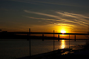 The sun sets over the Mississippi River on an early winter evening.