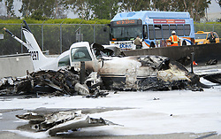 June 30, 2017 - Irvine, CA, USA - The airport exit is stopped to traffic after a small plane crashes on I-405 freeway at MacArthur in Irvine, CA, missing the runway at John Wayne Airport, injuries are unknown Friday, June 30, 2017. (Credit Image: © Ken Steinhardt/The Orange County Register via ZUMA Wire)