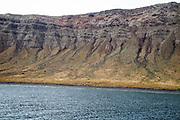 Steep gullied cliffs near Punta Fariones, Chinijo Archipelago, Orzola, Lanzarote, Canary Islands, Spain