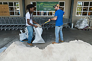 Workers fill sand bags outside a Whole Foods Market in preparation for Hurricane Irma September 8, 2017 in Mount Pleasant, South Carolina. Imra is expected to spare the Charleston area but hurricane preparations continue as Irma leaves a path of destruction across the Caribbean.