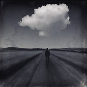 man running down a country road - abstract photograph