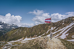 THEMENBILD - Österreich Fahne am Fuschertoerl umringt von der Bergwelt. Die Hochalpenstrasse verbindet die beiden Bundeslaender Salzburg und Kaernten und ist als Erlebnisstrasse vorrangig von touristischer Bedeutung, aufgenommen am 11. Juni 2020 in Fusch a.d. Glstr., Österreich // Austria flag at Fuschertoerl surrounded by mountains. The High Alpine Road connects the two provinces of Salzburg and Carinthia and is as an adventure road priority of tourist interest, Fusch a.d. Glstr., Austria on 2020/06/11. EXPA Pictures © 2020, PhotoCredit: EXPA/ JFK