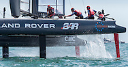 Duran Duran pop star Simon le Bon (top right with union jack on helmet) aboard Sir Ben Ainslie's AC45 foiling catamaran Land Rover BAR while competing in the second race of the America's Cup World Series near Portsmouth. <br /> Ainslie's team finished second in the race.<br /> Each boat in the fleet carries one guest at the back but they are not allowed to assist the sailing of the vessel.<br /> Land Rover BAR won the event and received their trophy from the Duchess of Cornwall.<br /> Picture date: Saturday July 25, 2015.<br /> Photograph by Christopher Ison ©<br /> 07544044177<br /> chris@christopherison.com<br /> www.christopherison.com