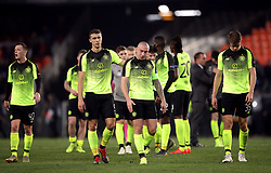Celtic's Jozo Simunovic (second left) and Scott Brown appear dejected after the match