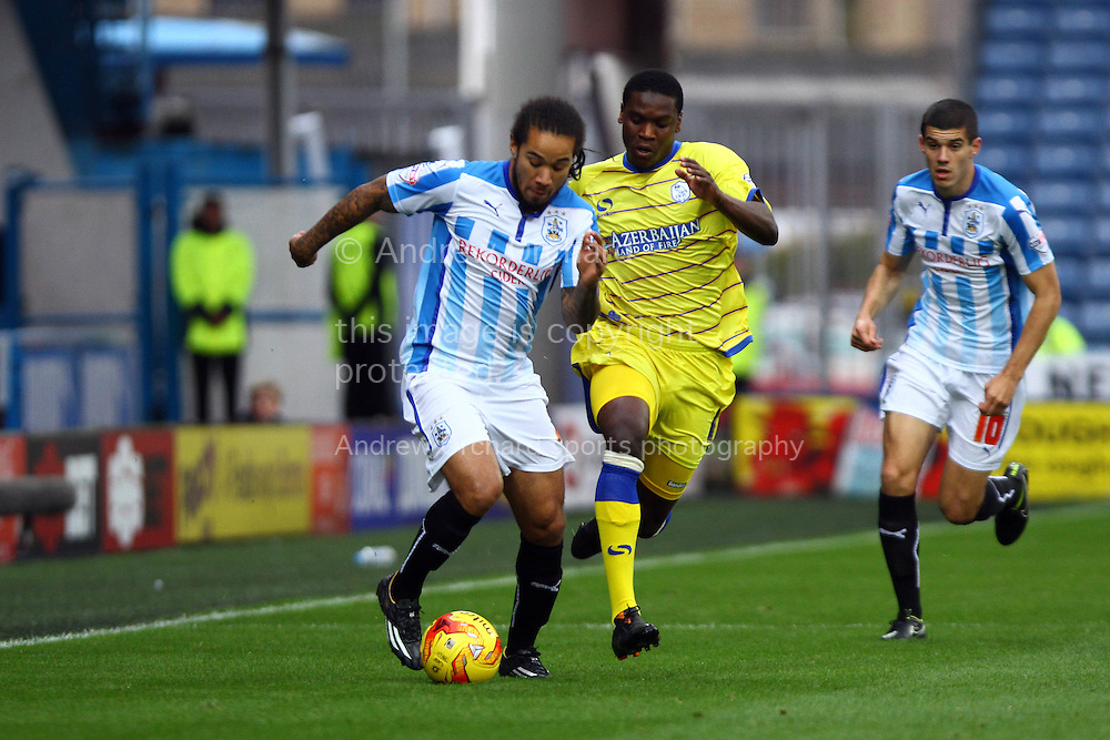 Sean Scannell of Huddersfield Town is chased by Gary Taylor-Fletcher of Sheffield Wednesdayl. Skybet football league championship match, Huddersfield Town v Sheffield Wednesday at the John Smith's stadium in Huddersfield, Yorkshire on Saturday 22nd November 2014.<br /> pic by Chris Stading, Andrew Orchard sports photography.