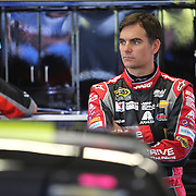 Driver Jeff Gordon waits in the garage area during the 56th Annual NASCAR Daytona 500 practice session that got delayed by rain, at Daytona International Speedway on Saturday, February 22, 2014 in Daytona Beach, Florida.  (AP Photo/Alex Menendez)