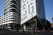 Architectural optical illusion building with peculiar angles M By Montcalm London Shoreditch Tech City hotel near Old Street in London, England, United Kingdom. East London Tech City, also known as Tech City and Silicon Roundabout, is the term for a technology cluster of high-tech companies located in Shoreditch and St Luke's in East London. A cluster of web businesses initially developed around the Old Street Roundabout in 2008. The area had historically been relatively run down compared to the nearby City. The 2008–09 recession further suppressed rents through the closure of numerous firms, making it affordable to technology start-ups, while redundancies from financial services companies, such as investment banks, released a pool of experienced talent interested in entrepreneurship.