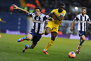 Yannick Bolasie of Crystal Palace breaks past Goran Popov of West Brom. . FA Cup with Budweiser, 3rd round, West Bromwich Albion v Crystal Palace match at the Hawthorns in Birmingham, England on Saturday 4th Jan 2014.<br /> pic by Andrew Orchard, Andrew Orchard sports photography.