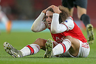Arsenal midfielder Mattéo Guendouzi (29) holds his head in disbelief after a foul wasn't given following a challenge during the Europa League match between Arsenal and Eintracht Frankfurt at the Emirates Stadium, London, England on 28 November 2019.