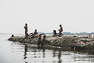 Children play at the sea in Aitape, a small town in Sandaun Province on the north coast of Papua New Guinea. On the right is some of the trash the kids have turned into toys.<br /><br />(July 19, 2017)