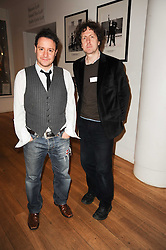 Left to right, writers and comedians JON HOLMES and STEVE PUNT at the annual Orion Publishing Group's Author party held in the Paul Hamlyn Hall, The Royal Opera House, Covent Garden, London on 22nd February 2010.