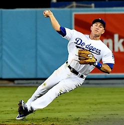 September 7, 2017 - Los Angeles, California, U.S. - Los Angeles Dodgers second baseman Chase Utley fields a ground ball as Colorado Rockies' Trevor Story (not pictured) beats the throw in the seventh inning of a Major League baseball game at Dodger Stadium on Thursday, Sept. 07, 2017 in Los Angeles. (Photo by Keith Birmingham, Pasadena Star-News/SCNG) (Credit Image: © San Gabriel Valley Tribune via ZUMA Wire)