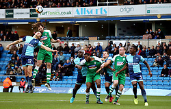 Wycombe Wanderers' Luke O'Nien (left) and Leatherhead's Jack Midson (second left) battle in the air whilst their team mates watch during the Emirates FA Cup, second round match at Adams Park, Wycombe.