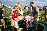 January 27 2016: New York Giants Eli Manning meets a young fan with his jersey on during the Pro Bowl Draft at Wheeler Army Base on Oahu, HI. (Photo by Aric Becker/Icon Sportswire)