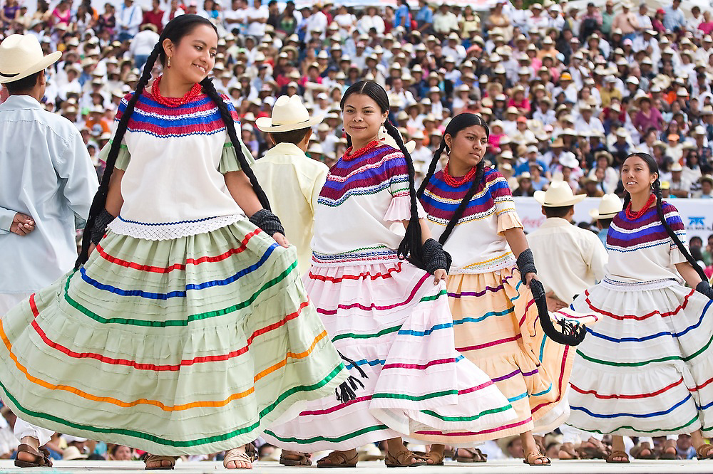 Dancers perform at the Guelaguetza Auditorium on Cerro del Fortin in Oaxaca City, Oaxaca state, Mexico on July 21, 2008. The Guelaguetza is an annual folk dance festival - dancers from all corners of the state gather in celebration in Oaxaca City and towns in the Central Valley to perform their traditional dances.