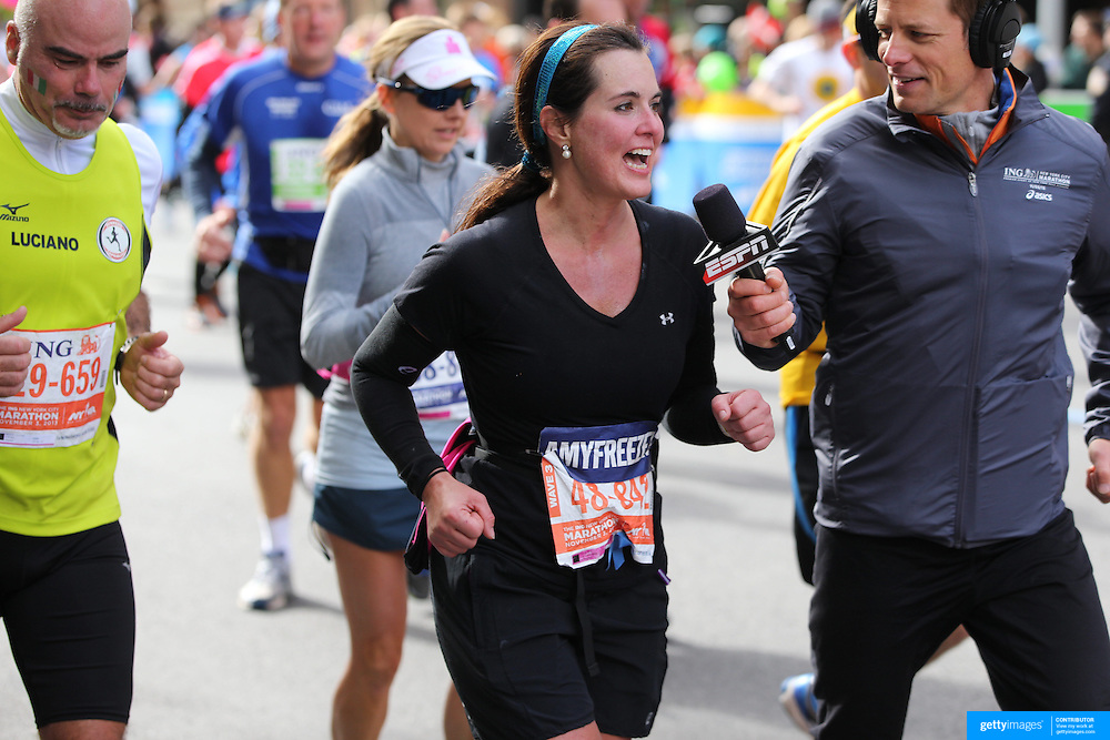 TV personality Amy Freeze, interviewed as runners make their way along First Avenue in Manhattan, New York, during the ING New York Marathon. New York, USA. 3rd November 2013. Photo Tim Clayton