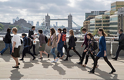 © Licensed to London News Pictures. 05/06/2017. London, UK. People use London Bridge for the first time following a terrorist attack in Saturday evening. Three men attacked members of the public  after a white van rammed pedestrians on London Bridge.   Ten people including the three suspected attackers were killed and 48 injured in the attack. Photo credit: Peter Macdiarmid/LNP