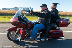 Mandy and Brett Schaible of the Old Cronies in Leola, SD riding his Harley-Davidson Road Glide in the USS South Dakota submarine flag relay across South Dakota. Groton, SD. USA. Sunday October 8, 2017. Photography ©2017 Michael Lichter.