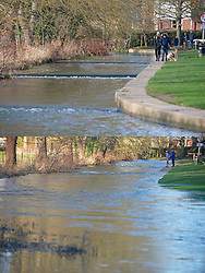 ©Licensed to London News Pictures 29/12/2019. <br /> Eynsford ,UK. Comparison pictures of Eynsford today (29.12.2019) and from flooding a week ago (23.12.2019) People get out and about in the sunny mild weather in Eynsford,Kent as the flood water from the river Darent recedes .Photo credit: Grant Falvey/LNP