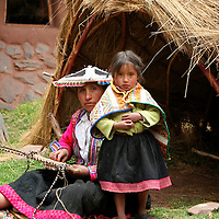 Americas, South America, Peru, Cusco. Mother and daughter weavers at Awana Kancha.