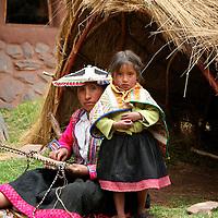 Americas, South America, Peru, Cusco. Mother and daughter weavers at Awana Kancha.