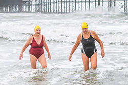 © Licensed to London News Pictures. 08/06/2019. Brighton, UK. Members of the Brighton Swimming Club brave the rough seas and strong winds on Saturday morning as the remnants of storm Miguel pass by Brighton and Hove. Photo credit: Hugo Michiels/LNP