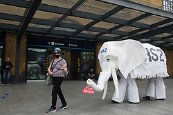 """Stop HS2 campaigners use a HS2 white elephant holding a £170bn sign during outreach activities on the occasion of a HS2 Routewide Roadshow at Kings Cross Square on 5th August 2021 in London, United Kingdom. There have been increasing doubts regarding the viability of the northern section of the HS2 high-speed rail link since a recent report published by the Infrastructure and Projects Authority gave Phase 2b the lowest 'red' rating, indicating that successful delivery of the scheme """"appears to be unachievable""""."""