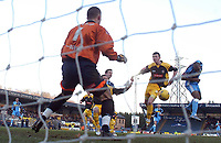 Photo: Alan Crowhurst.<br />Wycombe Wanderers v Stockport County. Coca Cola League 2. 28/01/2006. <br />Kevin Betsy (R) heads at goal for Wycombe.