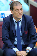 Slaven Bilic, West Ham United manager looks on from the dugout. UEFA Europa league, 3rd qualifying round match, 2nd leg, West Ham Utd v NK Domzale at the London Stadium, Queen Elizabeth Olympic Park in London on Thursday 4th August 2016.<br /> pic by John Patrick Fletcher, Andrew Orchard sports photography.