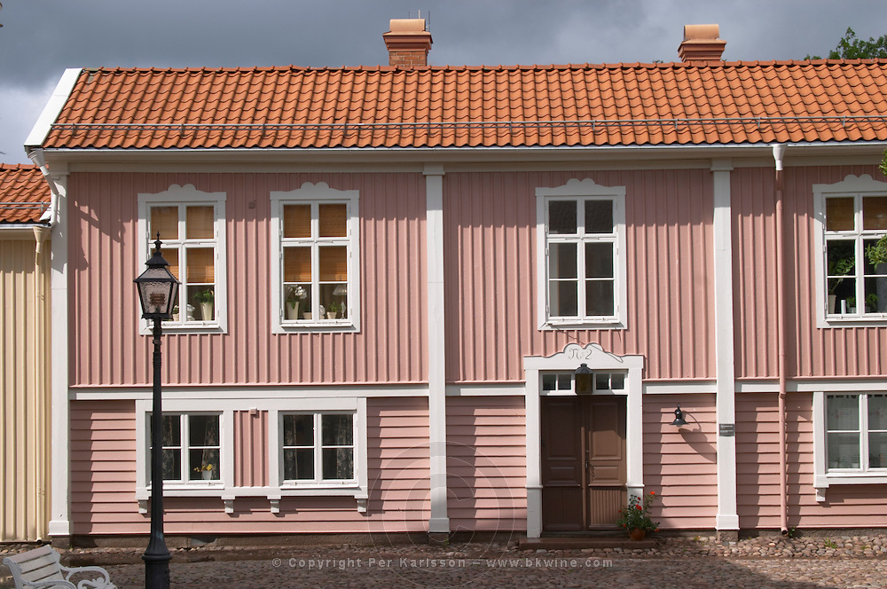 A street scene from the old town where there are many unique old wooden houses. Peder skomakares (shoe maker's) house. Eksjo town. Smaland region. Sweden, Europe.