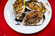 Oysters with dried onions for sale on the street in Hanoi, Vietnam, Asia