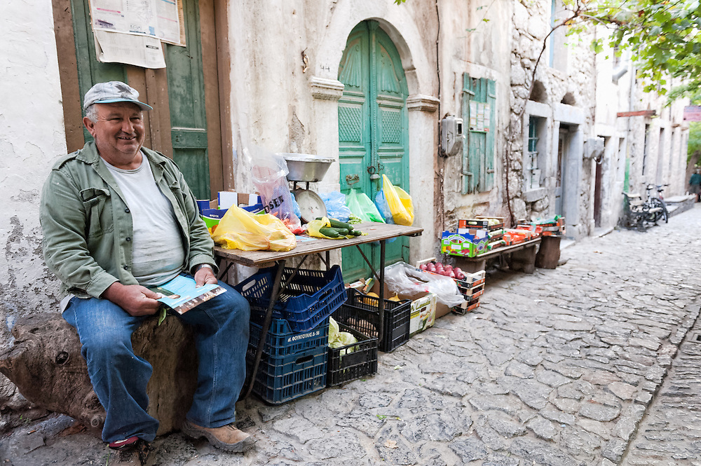 A street greengrocer in one of the alleys of the medieval village of Mesta, Chios, Greece.