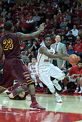 11 January 2014: Daishon Knight works the corner against Jeff White during an NCAA  mens basketball game between the Ramblers of Loyola University and the Illinois State Redbirds  in Redbird Arena, Normal IL.  Redbirds win 59-50