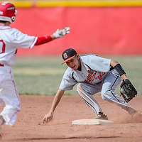 Gallup Bengal Josiah Francisco (23) grabs a grounder to stop Grants Pirate Jayden Lucero at second Tuesday in Grants.
