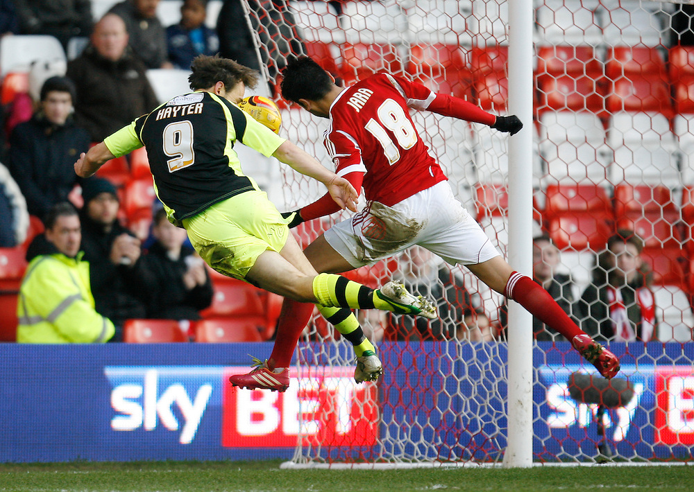 Yeovil Town's James Hayter (L) heads at goal<br /> <br /> Photo by Jack Phillips/CameraSport<br /> <br /> Football - The Football League Sky Bet Championship - Nottingham Forest v Yeovil Town - Sunday 2nd February 2014 - The City Ground - Nottingham<br /> <br /> © CameraSport - 43 Linden Ave. Countesthorpe. Leicester. England. LE8 5PG - Tel: +44 (0) 116 277 4147 - admin@camerasport.com - www.camerasport.com